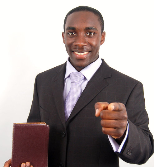 man pointing his finger while with his bible
